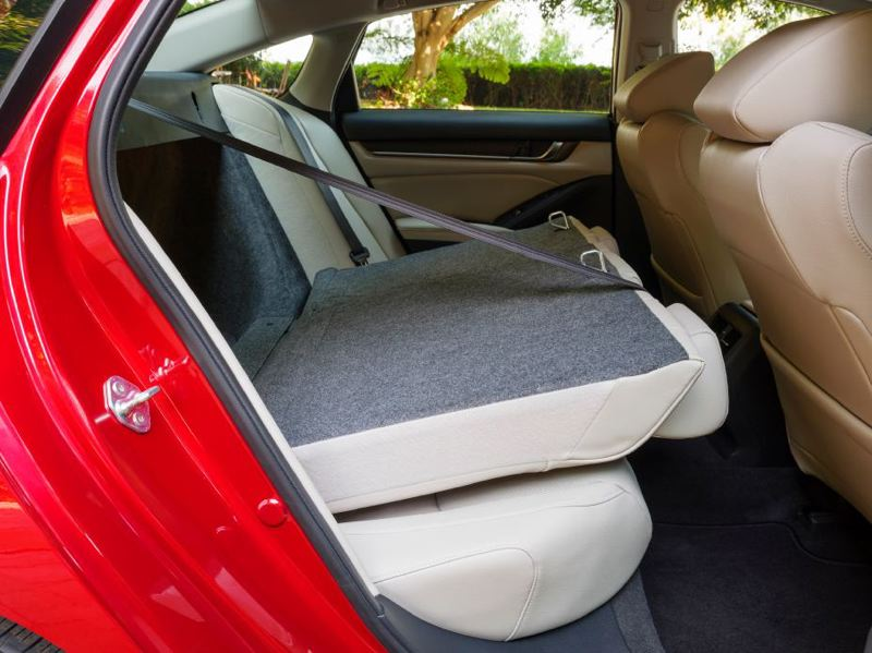 COURTESU HONDA - The rear seats of the 2021 Honda Accord Hybrid can hold three adults but also be folded down for extra cargo space.