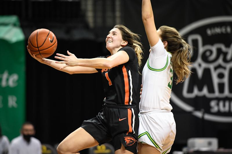 COURTESY PHOTO: KARL MAASDAM/OREGON STATE ATHLETICS - Aleah Goodman drives past Oregon's Taylor Chavez for two of her 20 points in Oregon Stat's 88-77 win over the Ducks on Sunday, Feb. 28 in Eugene.