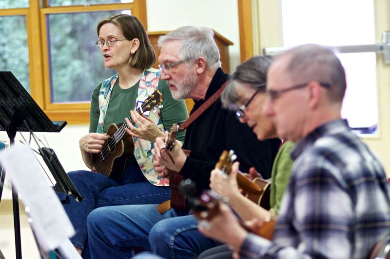 PMG FILE PHOTO - A ukulele jam group meets at the Beaverton Community Center in 2016. The building has been used by a variety of clubs and organizations over the years.