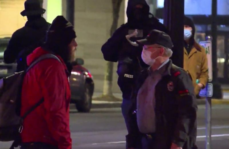 KOIN 6 NEWS - A protester confronts a reident in  the Pearl District on Saturday night.