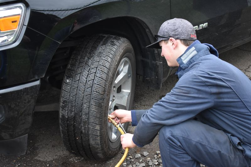 PMG FILE PHOTO - An Estacada automotive student works on a vehicle prior to the COVID-19 outbreak.