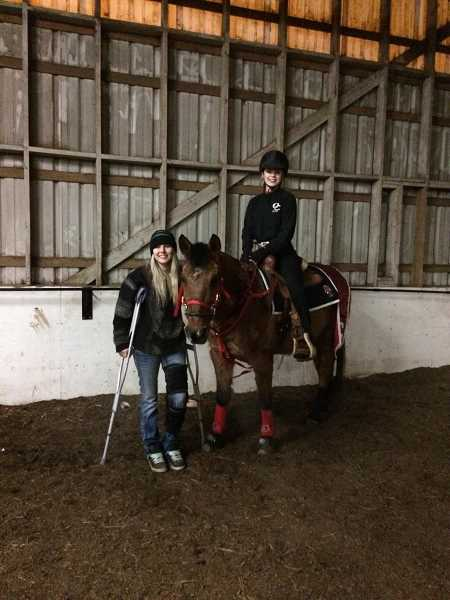 COURTESY PHOTO - Ashley Maestas comes injured to an Oregon City High School equestrian event to support former teammate Grace Steiner. Maestas said she was injured and then kicked off the equestrian team by coach Angie Wacker after warning about a badly behaved horse.