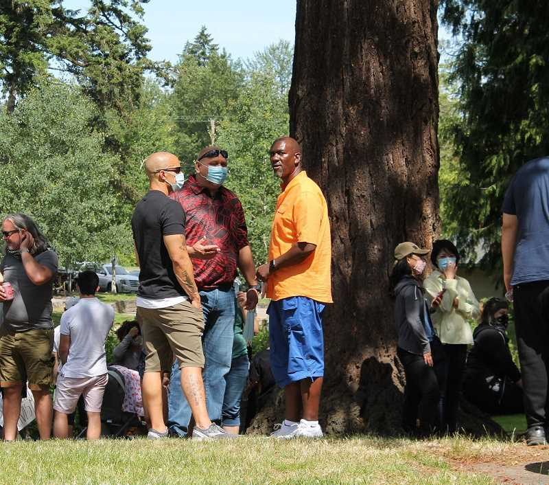 PMG FILE PHOTO - Michael Fesser (right) talks with Acting WLPD Chief Peter Mahuna and Captain Oddis Rollins at a Black Lives Matter event in West Linn over the summer., West Linn Tidings - News