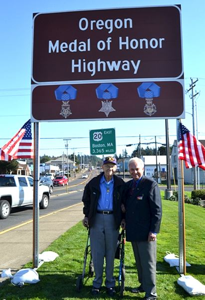 COURTESY PHOTO: DICK TOBIASON - Dick Tobiason of the Bend Heroes Foundation, right, joined Bob Maxwell to dedicate U.S. Highway 20's Medal of Honor Highway sign in Newport.