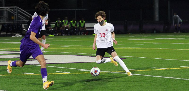 PMG PHOTO: MILES VANCE - Clackamas senior Brady Fendrich makes a move against Sunset during his team's 3-0 nonleague win at Sunset High School on March 2, the second day of high school sports competition in 2021.