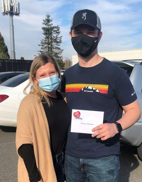 COURTESY PHOTO: GRESHAM FORD - Conor Stewart, a volunteer firefighter, received a gift card through The Love Project.