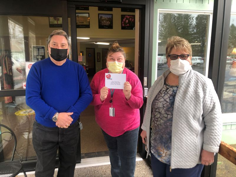 COURTESY PHOTO: GRESHAM FORD - Bess Wills and Bob Avila deliver a gift card to Good Samaritan Society Fairlawn Village Staff for caring for vulnerable people through the pandemic.