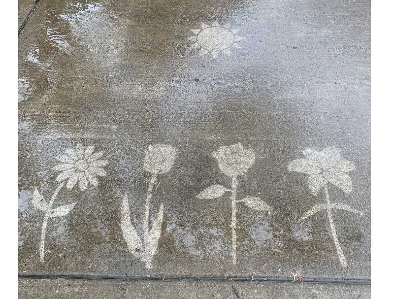 Rain reveals artwork in Sherwood