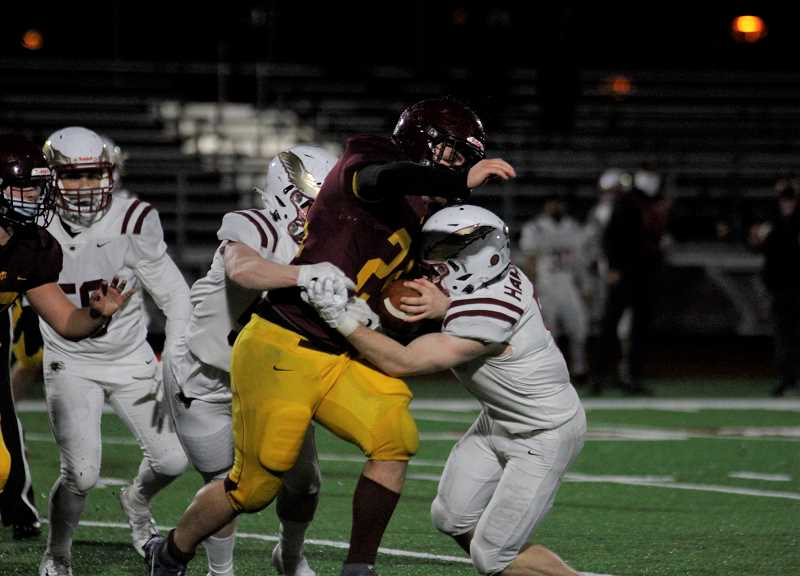 PMG PHOTO: WADE EVANSON - Forest Grove junior running back Gavin Hale carries the ball during the Vikings' game against Southridge Friday, March 5, at Forest Grove High School.