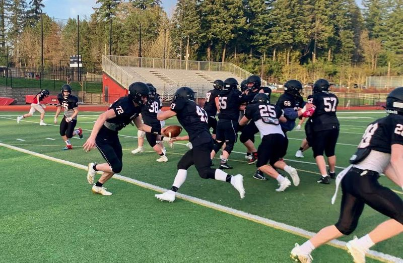 COURTESY PHOTO: SANDY FOOTBALL - Sandy football is excited to be playing despite the bizarre circumstances. The Pioneers had a tough first game, losing 40-0 at Sunset.