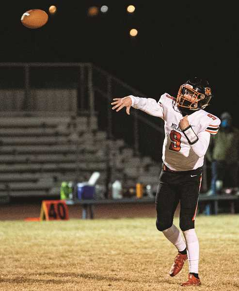 PMG PHOTO: LON AUSTIN - Molalla quarterback Isaac Thomas Klementis throws for a score in the first half of Friday's season-opening win over Madras.