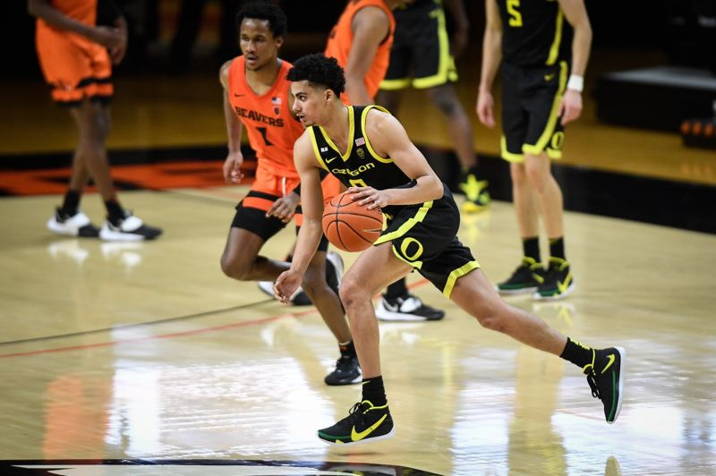 COURTESY PHOTO: KARL MAASDAM/OSU ATHLETICS - Oregon's Will Richardson dribbles up the floor in the Ducks' Sunday win at Gill Coliseum. The junior guard scored 22 points and led the Ducks to another Pac-12 regular-season title.