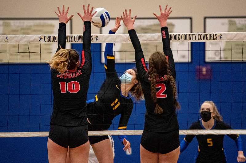 LON AUSTIN - Liz Barker, 11, rips a spike during the Cowgirls' win over Mt. View March 4. Barker finished the game with seven kills, as did McKenzie Jonas. Kendall Maycott led everyone in kills with 11. CCHS hosts Redmond tonight. However, no fans are allowed due to COVID protocols.