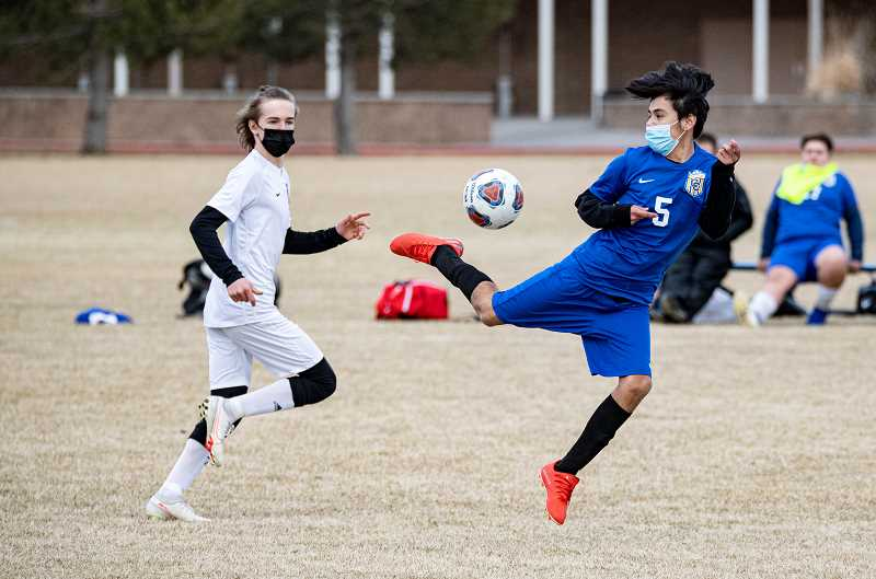 LON AUSTIN - Zarate Eusubio flips a kick during the Cowboys' 8-0 loss to Sisters on the Crook County field March 5. It was a defensive struggle early on and Crook County trailed just 1-0 at the break. However, after halftime, the Outlaws exploded for seven goals.