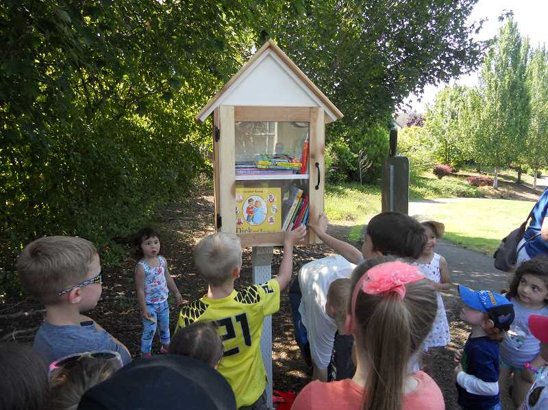 PMG PHOTO: SCOTT KEITH - Children flock to grab a book from the Little Free Library in  King City Community Park. The libary has been open since 2019.