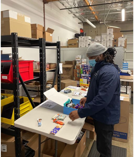 COURTESY: REMOTE BREAKROOM - A staffer packing snacks at Remote Breakroom's Seattle warehouse. On quiet weeks Portland clients' boxes are trucked down from Seattle, but the Portland warehouse is expecting a boom as the hybrid office-WFH takes hold in 2021.