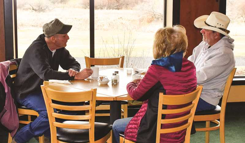 RAMONA MCCALLISTER - Customers enjoy coffee while waiting for breakfast at Ron's Comfort Food Cafe on a Monday morning. The restaurant is owned and operated by Ron and Cathy Allen.