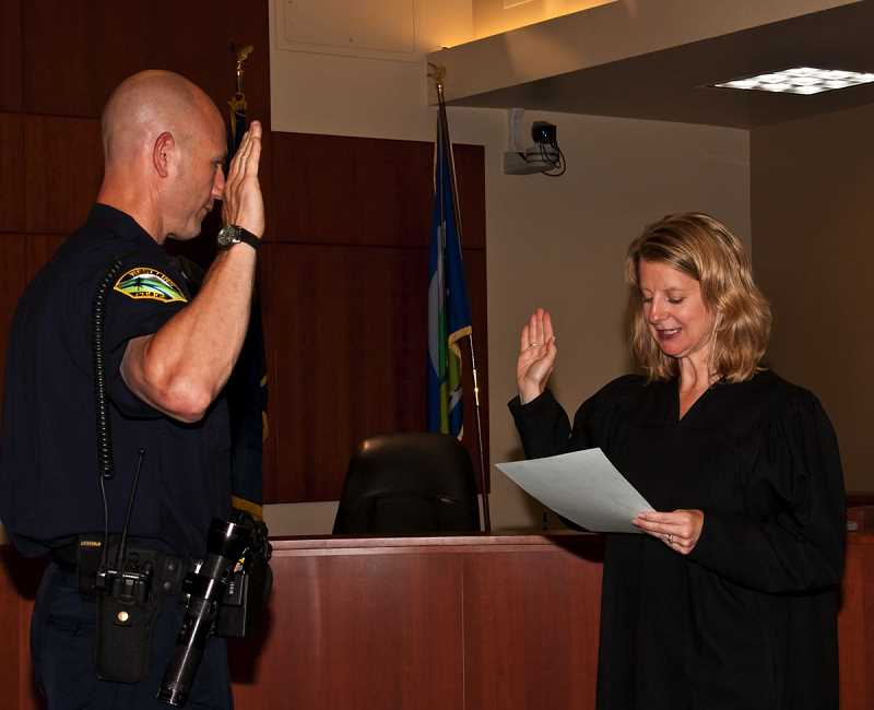 PMG FILE PHOTO - Mike Stradley was sworn in as a West Linn Police officer in July of 2011.
