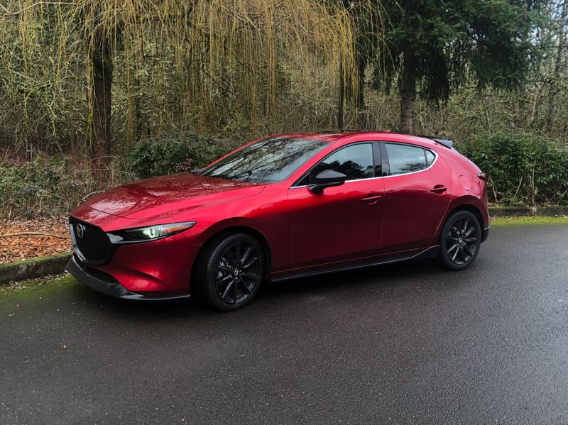 PMG PHOTO: JEFF ZURSCHMEIDE - The 2021 Mazda3 is available as a sedan or hatchback, with front-wheel-drive or all-wheel-drive, and both can now be ordered with a turbocharged 2.5-liter engine.