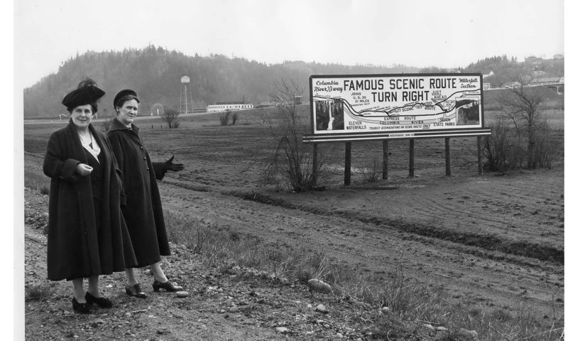COURTESY PHOTO: TROUTDALE HISTORICAL SOCIETY - Gertrude Jensen, left, and an unknown companion, came to Troutdale as the freeway was beginning in the late 1940s to promote a billboard urging drivers to enjoy the Historic Columbia River Highway.