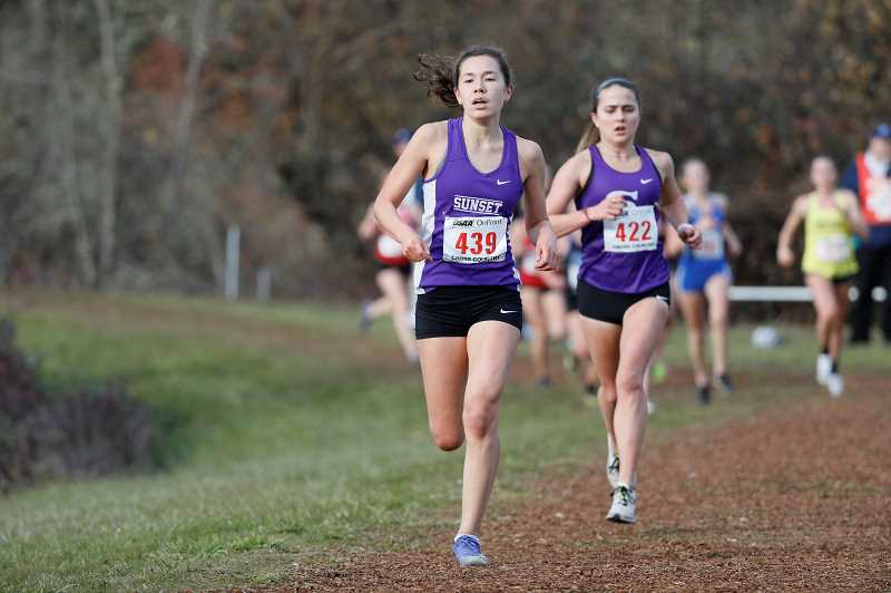 PMG FILE PHOTO - Sunset boys and girls cross country teams in competed in and placed third and fifth at last years state championships. This year, runners have to wear masks while practicing and competing.