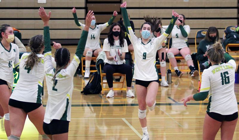 PMG PHOTO: MILES VANCE - West Linn freshman Olivia Doel celebrates one of her two late aces during the Lions' 3-0 win over Lakeridge on Thursday, March 11, at West Linn High School.