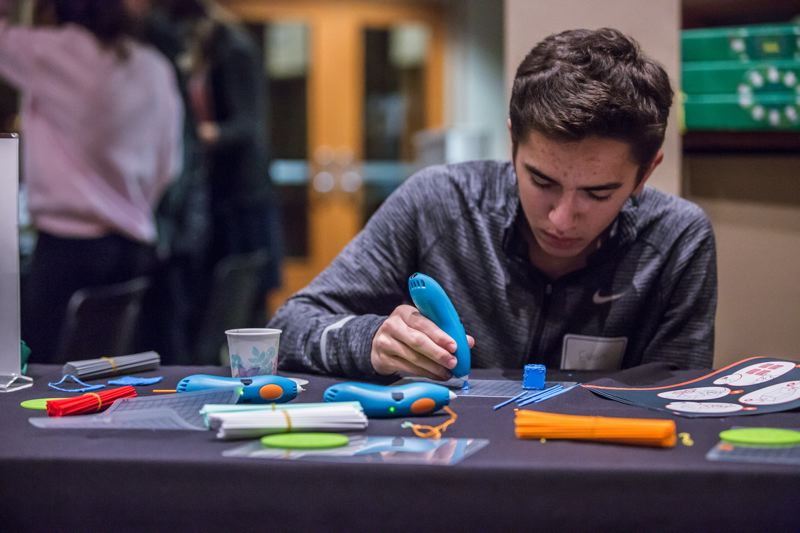 PMG FILE PHOTO - Evan Marx uses a 3Doodler Pen during a makerspace event in Tualatin in 2017. Several Washington County libraries have introduced a 'library of things' with educational materials and gadgets that can be checked out.