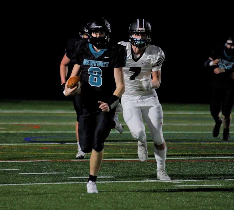 PMG PHOTO: WADE EVANSON - Century quarterback Zachary Boehler takes off running during the Jaguars' 17-14 win over Glencoe Friday night, March 12, at Century High School.