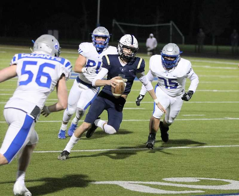 COURTESY PHOTO: STEWART MONROE - Banks quarterback Cooper Gobel scrambles from the pocket during the Braves' 48-0 win over Valley Catholic Friday night, March 12, at Valley Catholic High School.