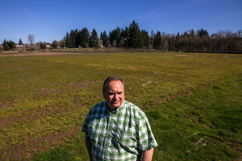 PMG PHOTO: JAIME VALDEZ - Rich Fiala stands in the middle of his family's farm, Fiala Farms, that he intends to keep intact for many years to come in the Stanford hamlet, which has faced development pressure.