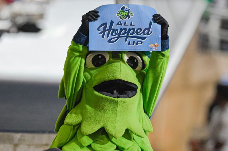 PMG FILE PHOTO - Hillsboro Hops mascot Barley T. Hop holds up a sign during game one of the Northwest League Championships against the Tri-City Dust Devils on Sept. 7, 2019.
