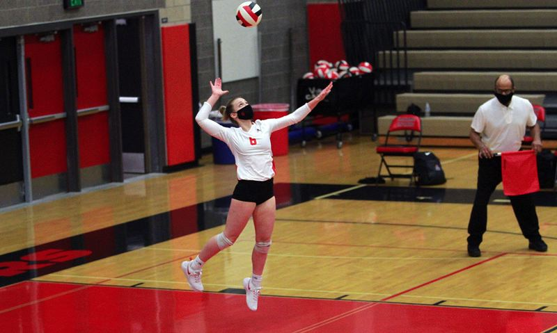 PMG PHOTO: MILES VANCE - Clackamas senior libero Kylie Hegar leaps to make a jump serve during her team's 3-0 win over David Douglas on Wednesday, March 17, at Clackamas High School.
