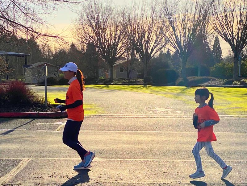 COURTESY PHOTO: HIEN WANG - Hien Wang is joined for a portion of a training run by her 7-year-old daughter, Nora. Wang will be doing the distance of six marathons in six days in April as part of a national cross-country relay, MS Run the US, to raise funds for multiple sclerosis research.