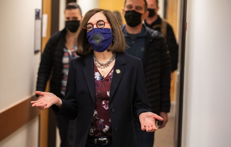 PMG PHOTO: JONATHAN HOUSE - Gov. Kate Brown arrives for her vaccine appointment at the OHSU Primary Care Clinic in Scappoose on Saturday, March 6. She testified before the Legislature on a plan to expand the number of Oregonians with health insurance.