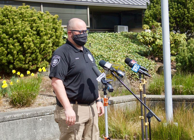 PMG PHOTO: CHRISTOPHER KEIZUR - Gresham Officer Adam Baker spoke during a press conference Thursday afternoon, March 18, following a motel shooting that left four injured.