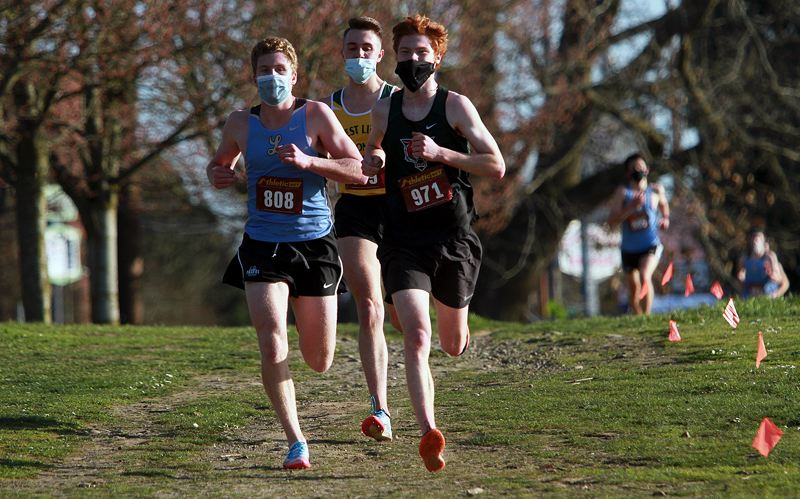 PMG PHOTO: MILES VANCE - Lakeridge's Wilson Godfrey (from left), West Linn's Jaiden Fishbein and Tigard's Lincoln Woodhouse race down a hill during the Three Rivers League meet at Portland's Fernhill Park on Wednesday, March 17.