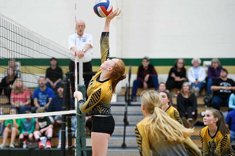 PMG FILE PHOTO - Gaston's Maya Rosenberg reaches high for a ball during a Greyhounds match last season at Gaston High School. Roseberg is a returning all-league player.