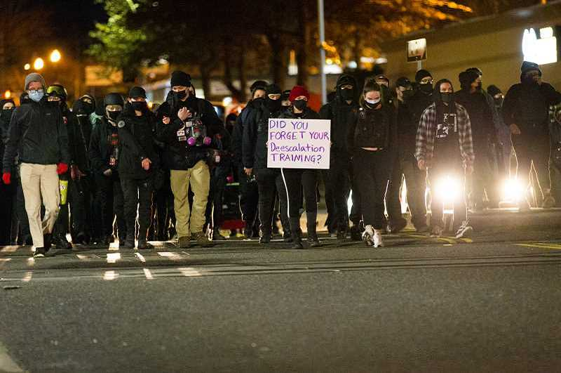 PMG FILE PHOTO: JAIME VALDEZ - The Jan. 7 protest march that was later deemed a riot resulted in more than $100,000 in damages to downtown businesses and the Tigard City Hall/Police Department complex.