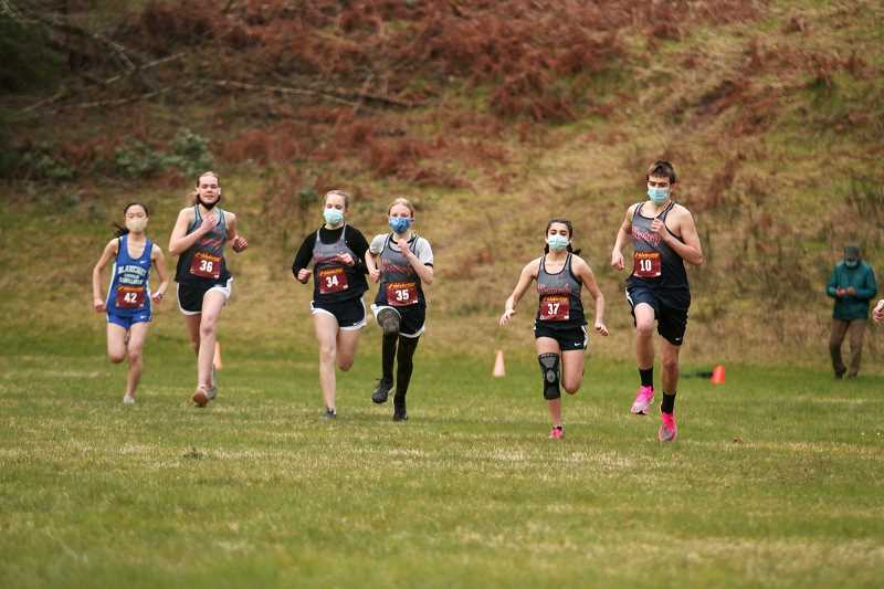 PMG PHOTO: PHIL HAWKINS - The Kennedy Trojans will be among the 70-plus schools to compete at the season-ending cross country race at Cheadle Lake Park in Lebanon on April 10.