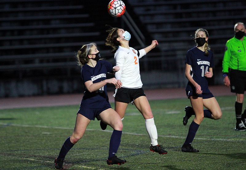 PMG PHOTO: MILES VANCE - Scappoose senior Anika Havlik makes a running header during her team's 3-0 loss to Wilsonville at Wilsonville High School on Thursday, March 18.
