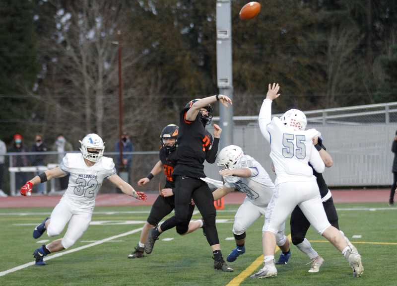 PMG PHOTO: WADE EVANSON - Scappoose quarterback Lukas McNabb throws a pass from the pocket during the Indians' game against Hillsboro Friday, March 19 at St. Helens High School.