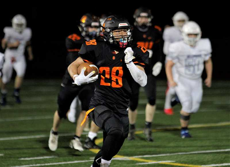 PMG PHOTO: WADE EVANSON - Scappoose's D'ANGELO MACEDO-BECKER runs in the open field during the Indians' game against Hillsboro Friday, March 19 at St. Helens High School.