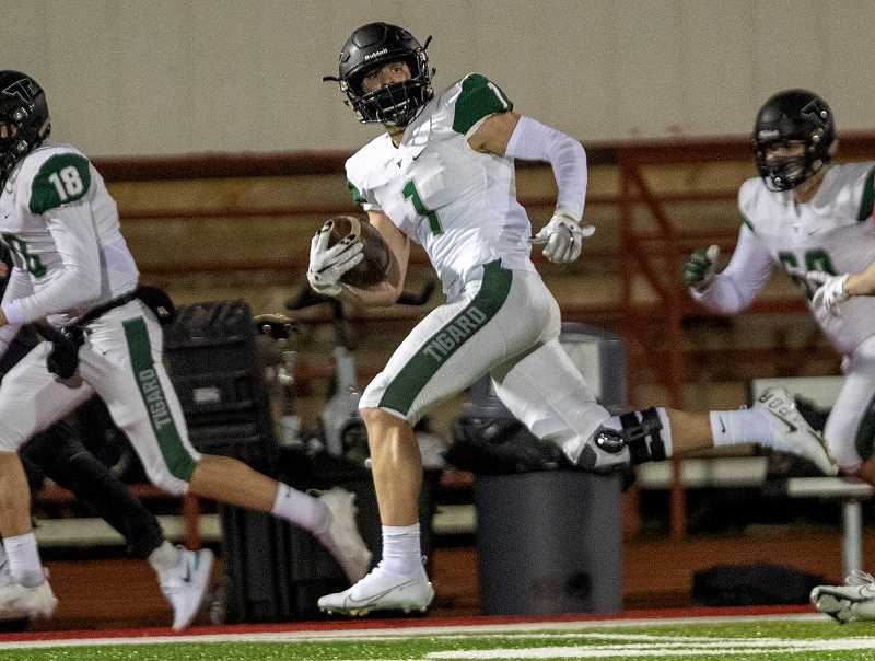 PMG FILE PHOTO: JAIME VALDEZ - Tigers' game against Oregon City in week-1. Tigard lost to West Linn 35-15 Friday night, March 19, at Tigard High School.