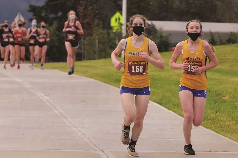 PMG PHOTO: GARY ALLEN - The NHS girls cross-country team finished third in a three-way meet with McMInnville and Sherwood in Sherwood on Saturday morning.