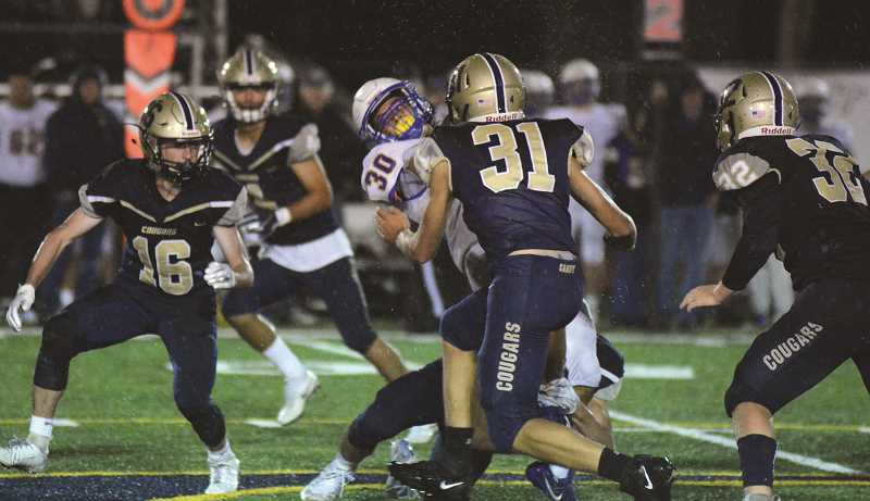 FILE PHOTO - The Canby High football team walked away with a 28-27 overtime win against Cascade Friday night.