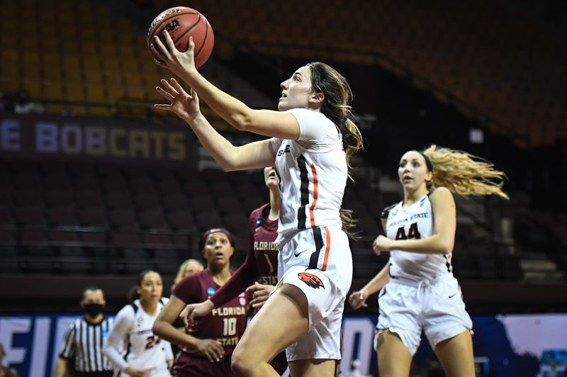 COURTESY PHOTO: KARL MAASDAM/OSU ATHLETICS - Aleah Goodman drives for two of her 24 points on Sunday in Oregon State's 83-59 win over Florida State in the first round of the NCAA Women's Basketball Tournament at San Marcos, Texas.