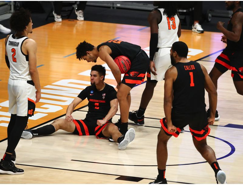 COURTESY PHOTO: NCAA PHOTOS - Jarod Lucas had a memorable three-point play, being knocked down on a made layup and then making the free throws, a symbolic sort of scoring play in Oregon State's 80-70 win over Oklahoma State and NBA prospect Cade Cunningham (left).