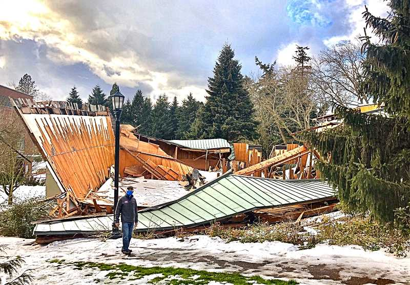 COURTESY OF CARRIE BALDWIN-SAYRE & REED COLLEGE - Michael Lombardo, Director of Reeds Athletic, Fitness, and Outdoor Programs, stands before the ruins of Reed Colleges Gym I and Gym II after their collapse in February.