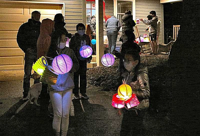 DAVID F. ASHTON - Families from all over the area, including those involved with the Woodstock Elementary School Mandarin Immersion Program participated in the Lunar New Year Parade.