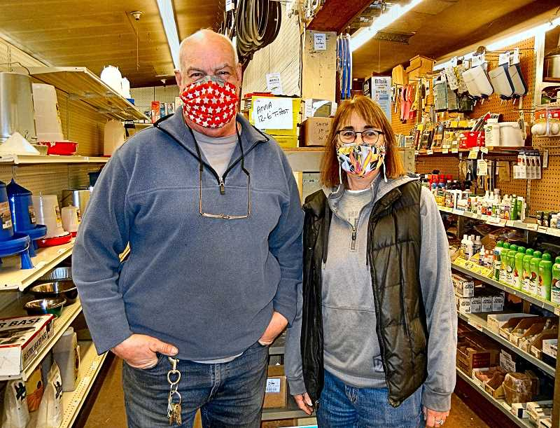 ELIZABETH USSHER GROFF - Brother and sister Tony Cassinellli and Pegg Cassinelli-Beeson had to replace many antique wooden shelves (such as at right) with pegboard and metal shelving (seen at left) after a pickup smashed through the wall into Wichita Feed & Hardware last November.
